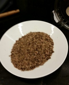 A bowl of ground up dried beef