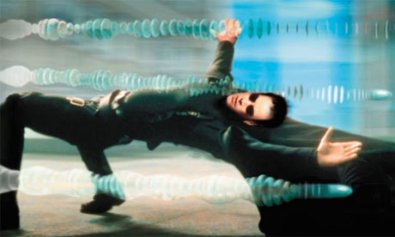 Neo dodging bullets in The Matrix (Warner Brothers 1999)